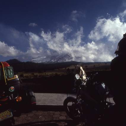 Cloud covered Popo. With the bikes at 13,000 feet.